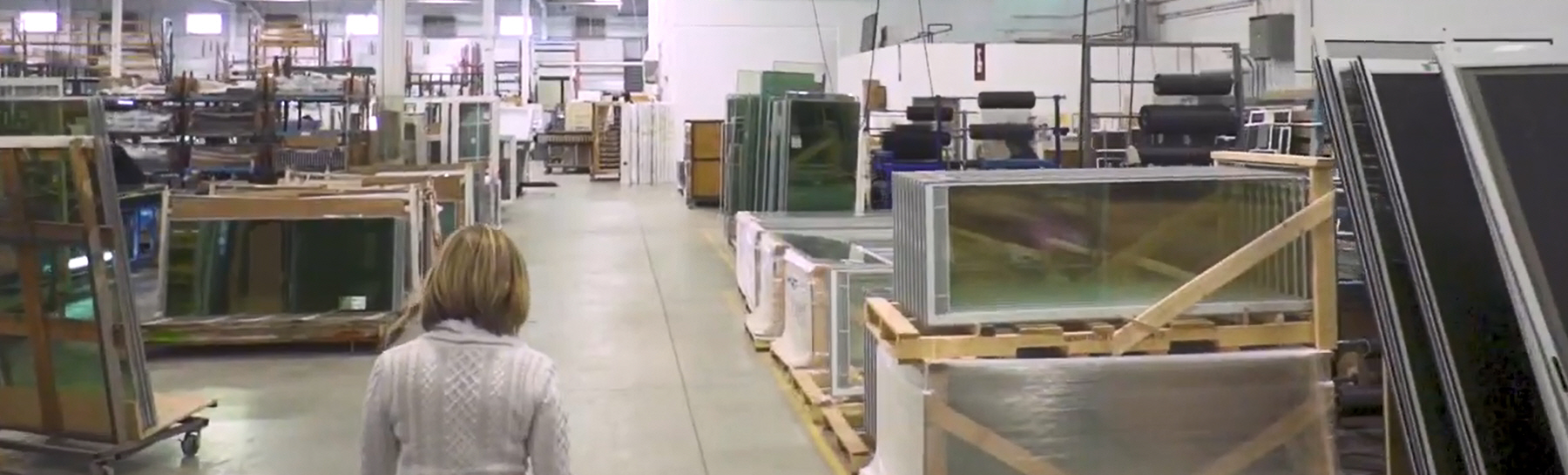 woman walking through a manufacturing plant